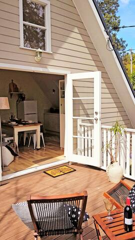 Open up the French doors onto your private deck