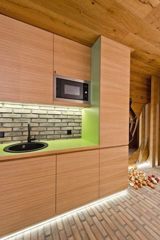 Kitchenette with all necessary equipment. Stove, microwave, dishes,glasses,  pots etc....