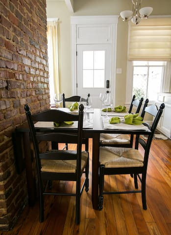 Exposed brick offers a warm dinner backdrop.
