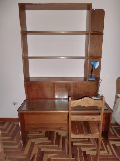 Large desk & shelving workstation in room