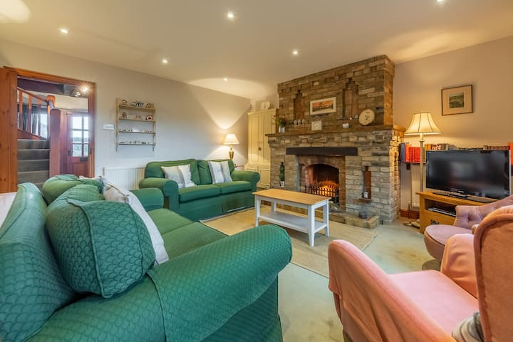 Ground floor: Sitting area with feature open fire