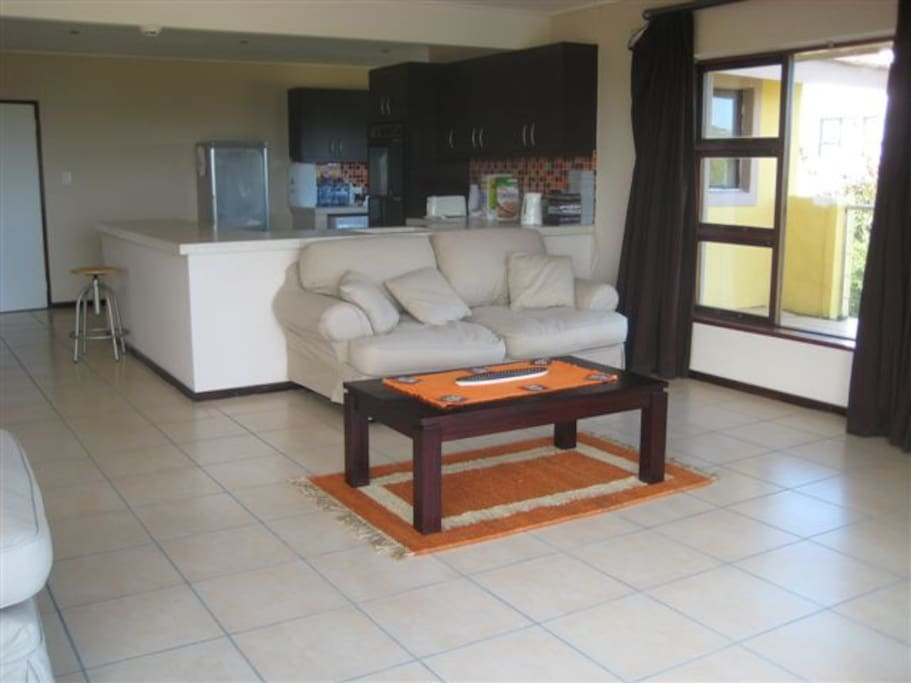 Sitting room / Dinning area, Fridge, Washing Machine and Dishwasher and Sleeper Couch