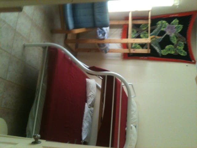ocean view bedroom one double bed and one single(bunkbeds)