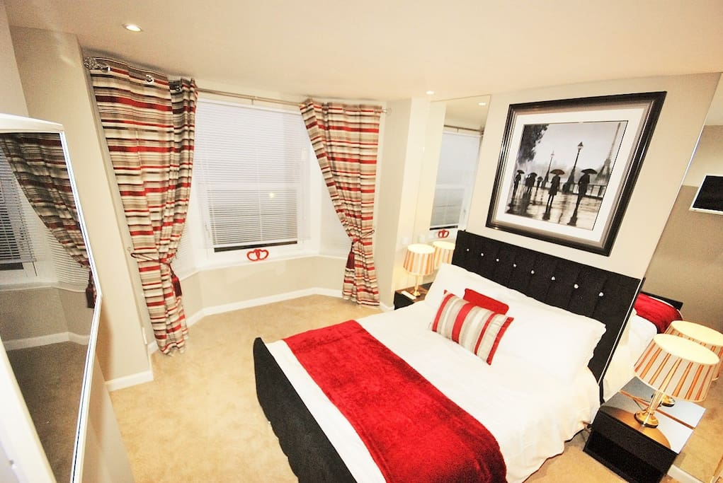 Master bedroom; built in wardrobes, double bed, tv/dvd on wall which is connected to the freesat box in lounge.