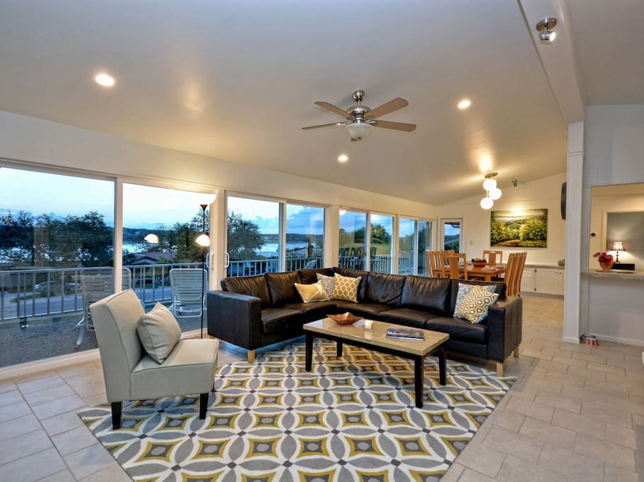 Lake Travis and Hill Country views continue in the elegant living area.