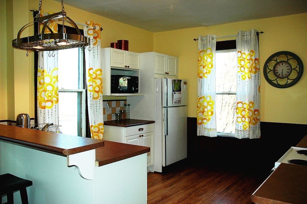 Sunny and spacious well equipped kitchen with pantry and breakfast bar