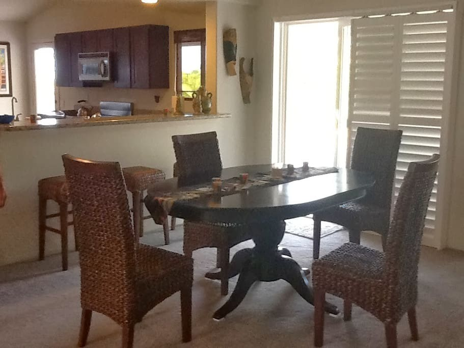 Sunny dining room with plantation shutters.