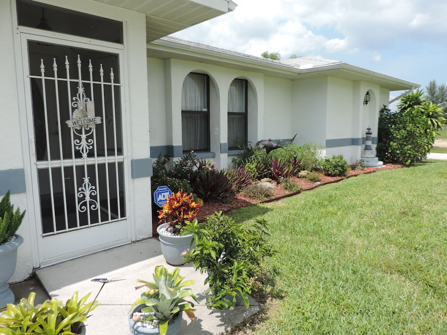 Front entry way and flower beds