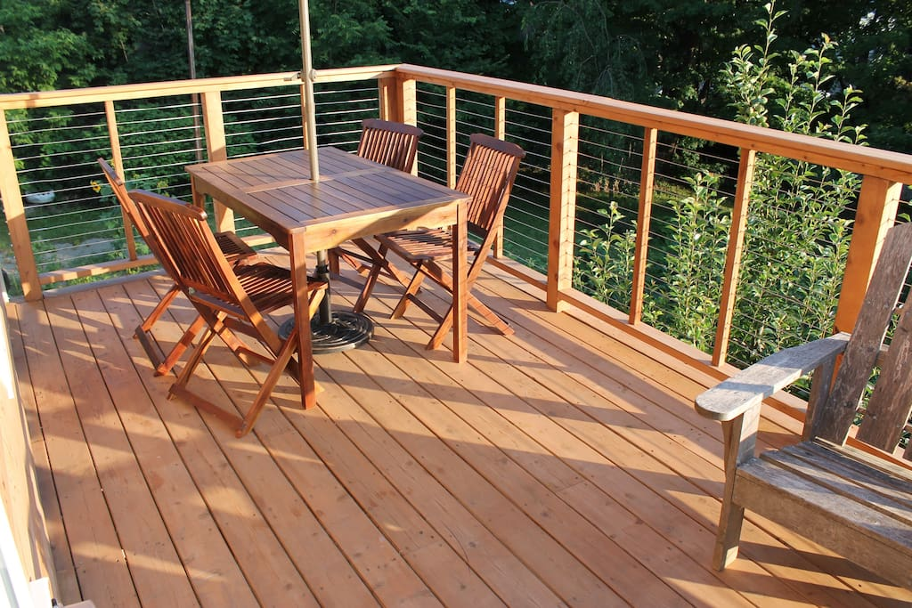 Large private deck with a table for dining