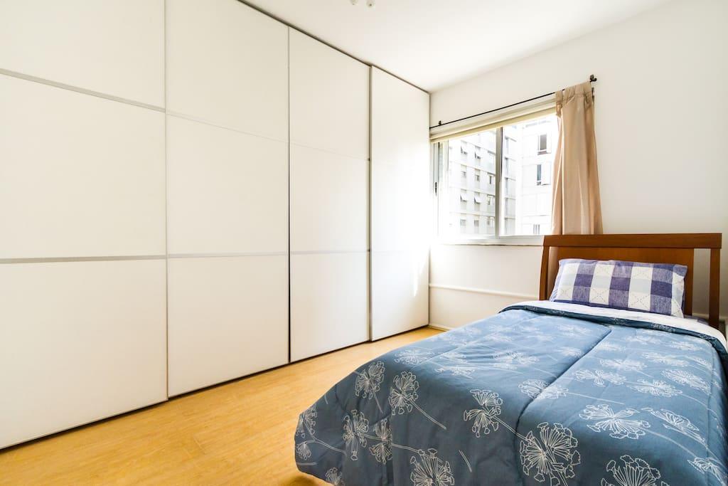 seu quarto de frente para rua tranquila (e com janela anti ruído) / This is your bedroom. It faces a quiet street and has double glazed window. Your private bathroom is right next door!