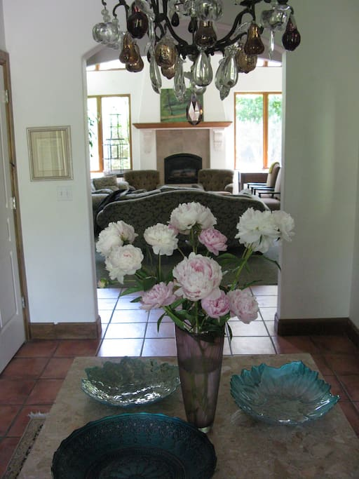 The front entrance with the 14th century French chandelier looking through to the living room