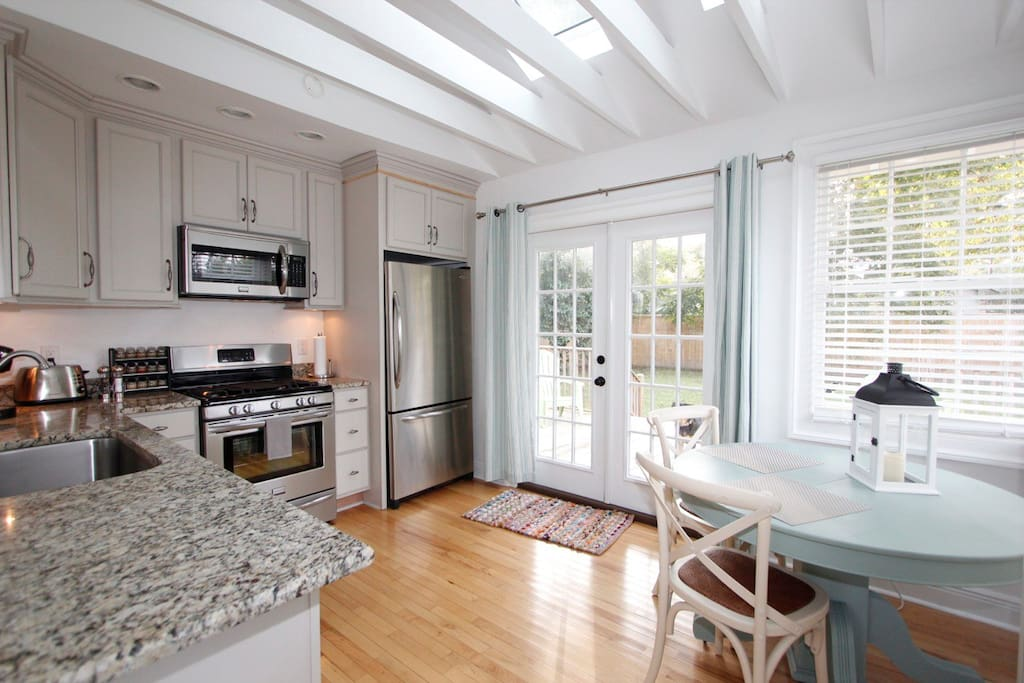 Fabulous Kitchen feauring stainless appliances, granite coutners + VELUX skylights and Exposed beams. French doors lead to deck overlooking a great back yard.
