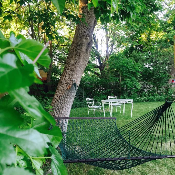 Large quiet backyard with hammock and dining areas