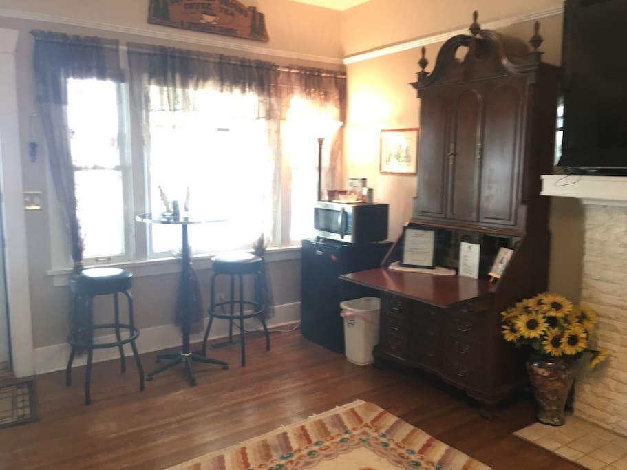 Living room's breakfast nook facing north and historic Linden trees surrounding home