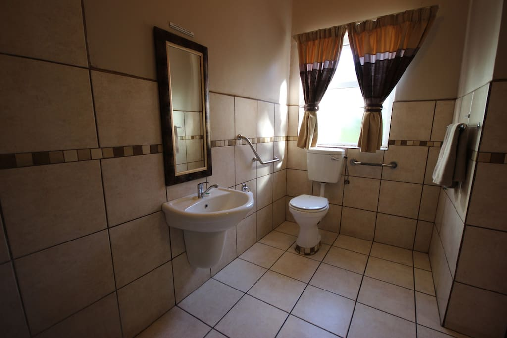 Toilet specially designed for handicapped guests. Front and side transfers.