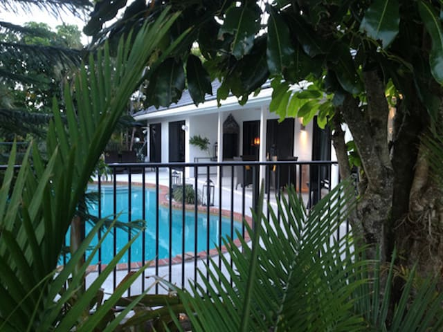 Private and intimate Backyard with an undercover patio invites you to our large heated pool.