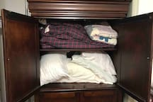 Extra pillows and blankets in Red Bedroom armoire