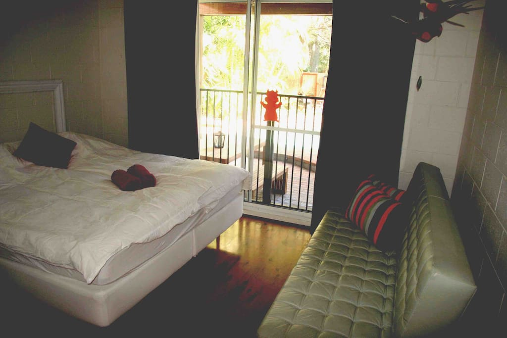 Main Bedroom with possible extra double. Access to pool.