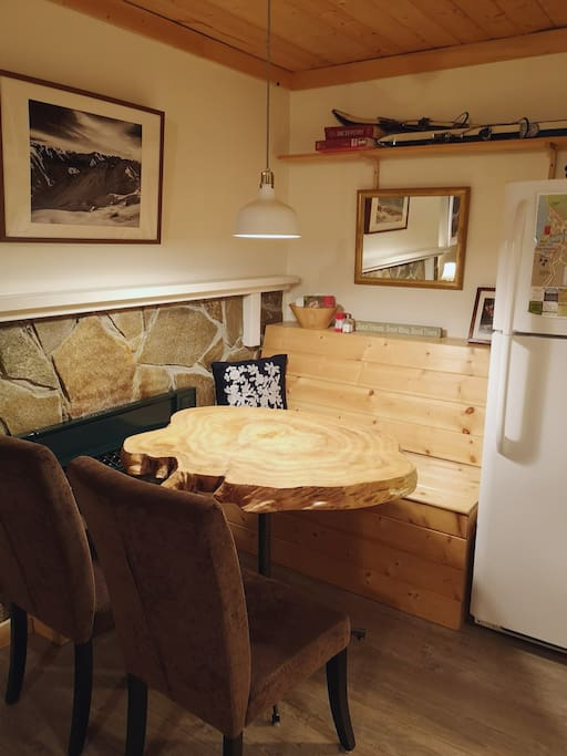 Live edge wood table, napkins, salt and pepper, and great place to enjoy a meal.