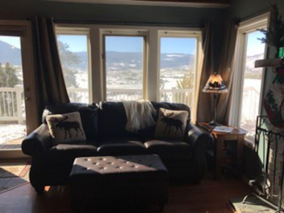 Family room looks over snowy mountain range