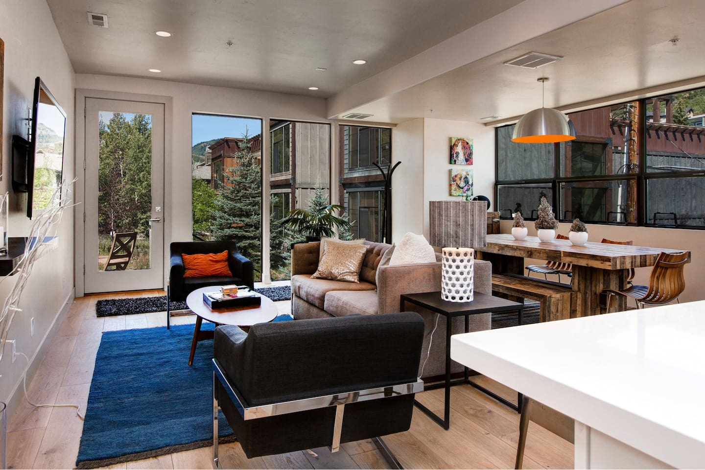 Welcome! An open concept gathering space features floor-to-ceiling views of downtown Park City and Rossie Mountain.