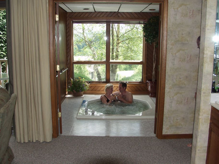 Jacuzzi has its own separate room with French doors and lovely view of resort