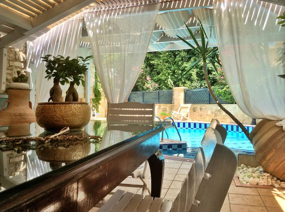 Villa Nepheli offers both indoors and open air dining areas..