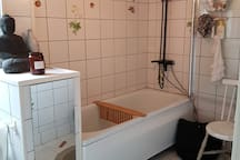 Shared bathroom with combined shower and bathtub.