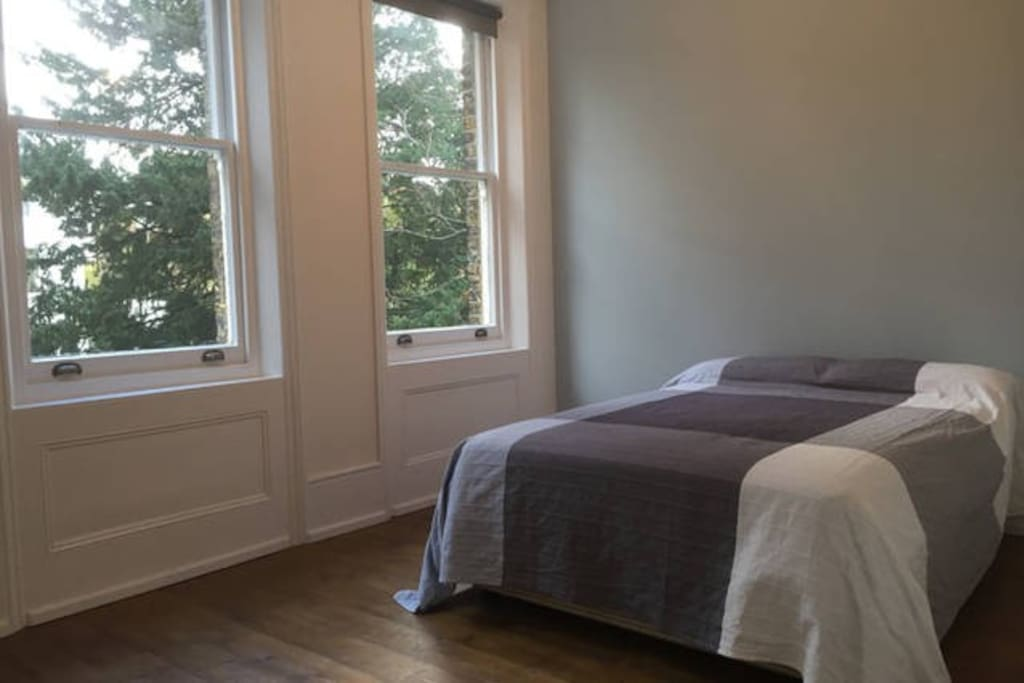 Very large double bedroom overlooking the front garden with a huge wardrobe & mirror