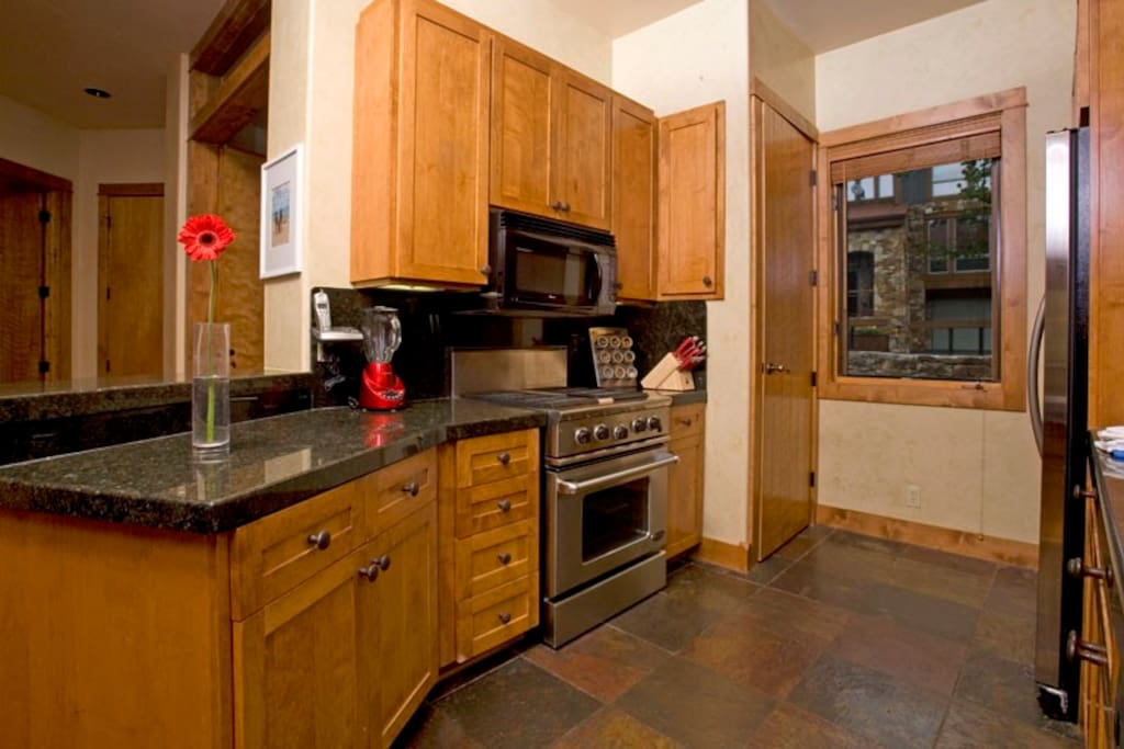 Whip up a great meal in the kitchen with granite countertops.
