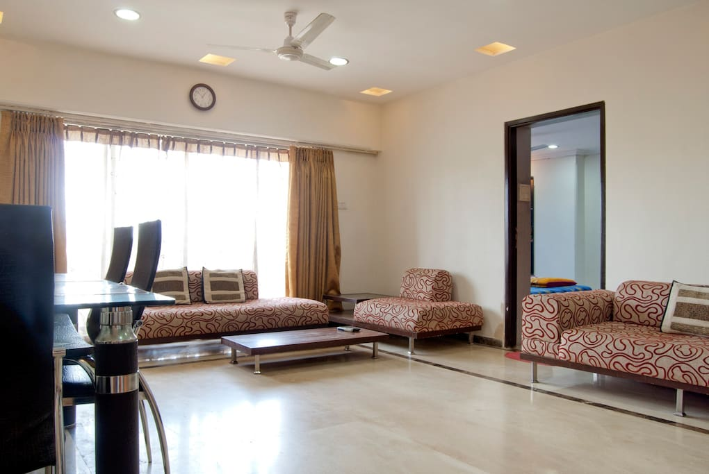living room with balcony overlooking main road