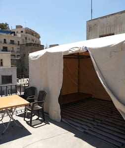 This listing is for a bed in a tent on the roof ,the views on all downtown Amman is amazing and you  can enjoy sitting area outside the tent , the bathroom is the floor under using the stairs 24 hours hot water and free wifi
