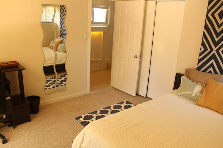 Welcome to the Pioneer's Pad! This room includes a Queen Size Bed, office desk and chair, and private access to the back patio and back yard.