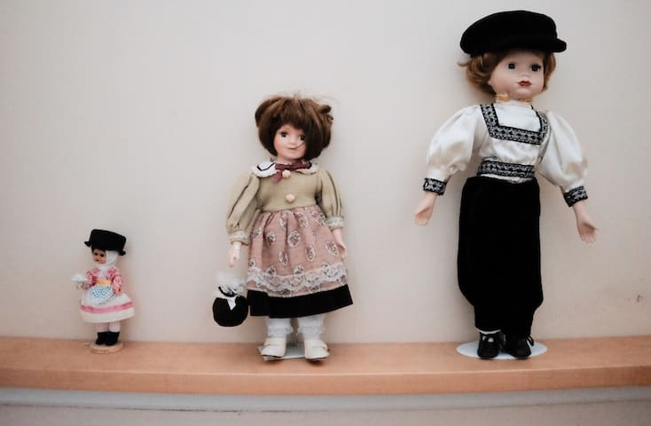Antique dolls in the stairs