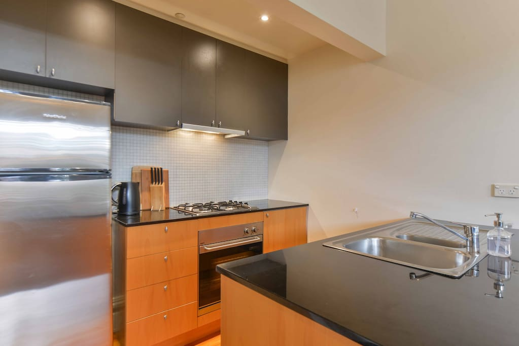 Kitchen with stainless steel appliances and granite benchtops