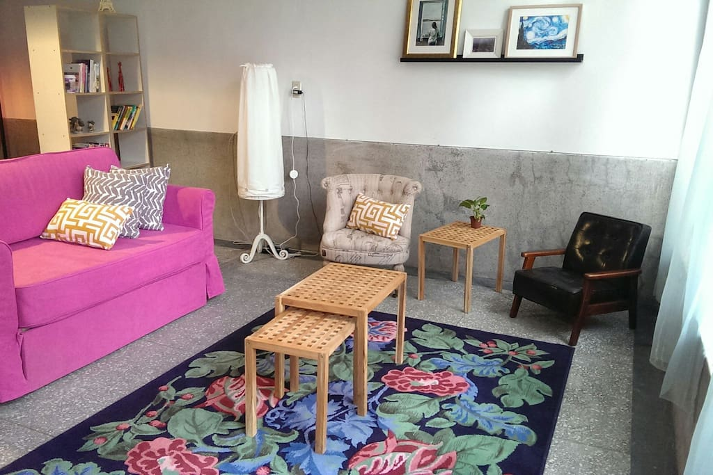 The pink sofa is a convertible sofa bed.