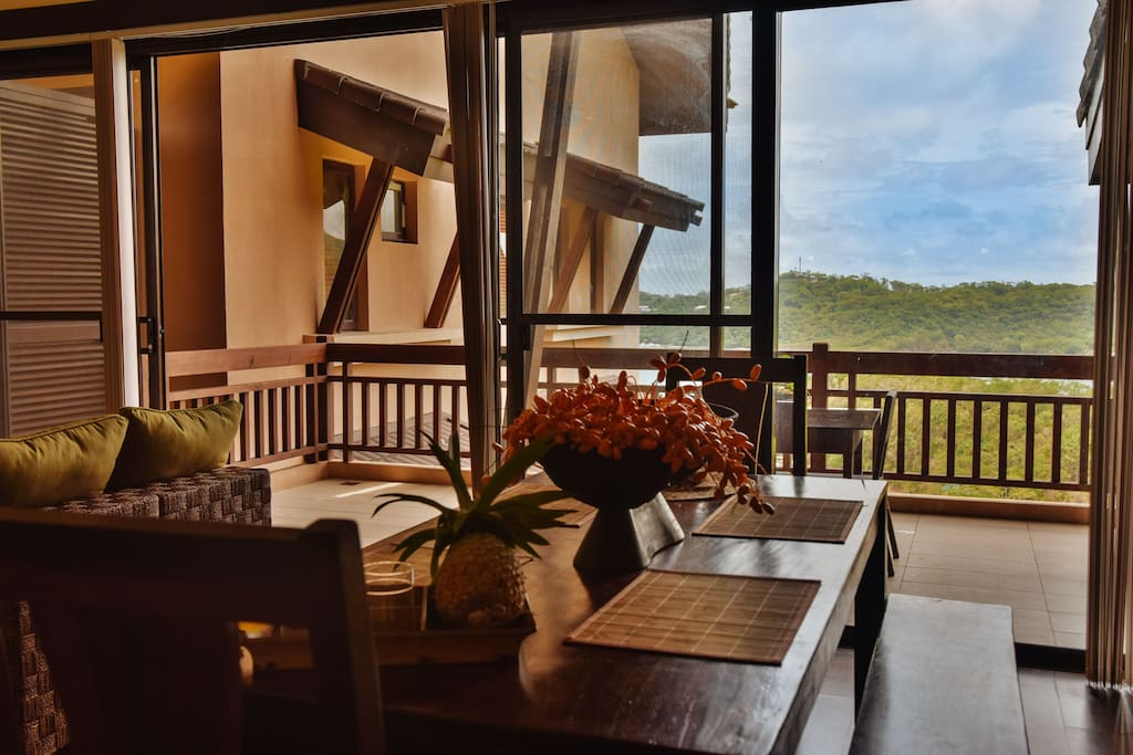Dining table is in main room with access to the spectacular view