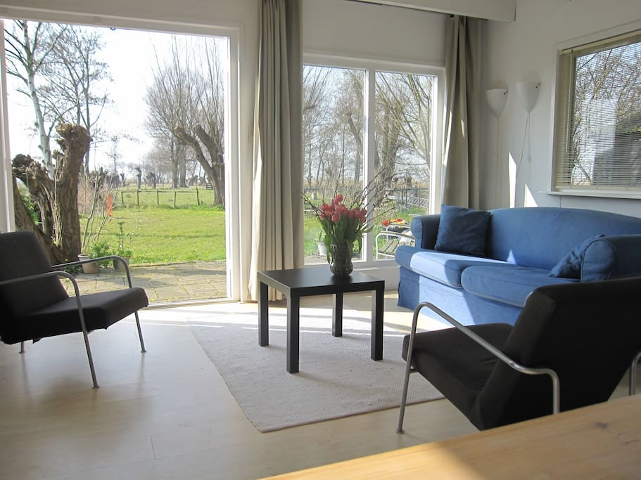 Living-room with french doors. The convertible sofa can transfer in a bed