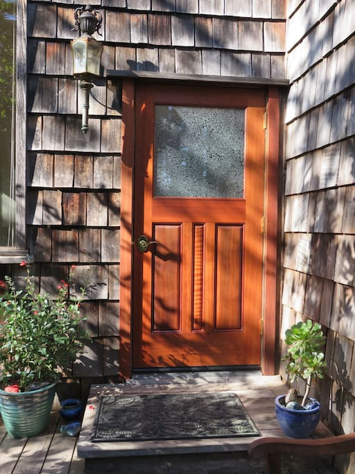 "Our ""new"" ancient Virgin Redwood door lovingly handmade by Brian Lee and Bob Winegar"