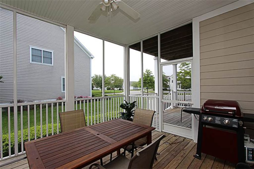 screened porch with gas grill