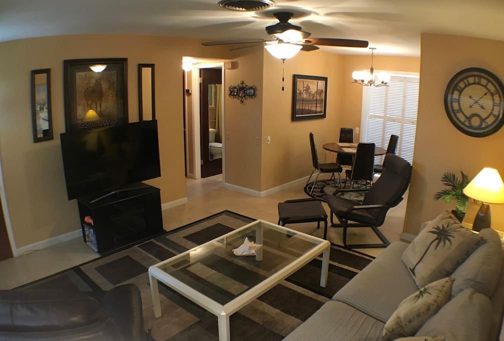 Another view of the comfortable main room that includes the TV, hallway to the bathroom & bedrooms.