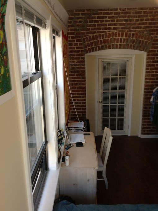 Nice brick walls, door to the living room.