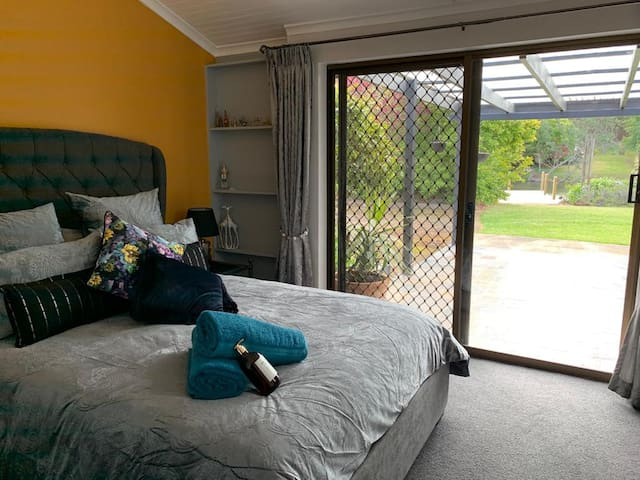 This bedroom is directly adjacent to the main bathroom..and has access to the garden.