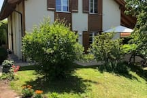 View of the house from the garden. The two guest rooms are on the first floor. Guests can enjoy the terrasse and garden shared with the hosts.