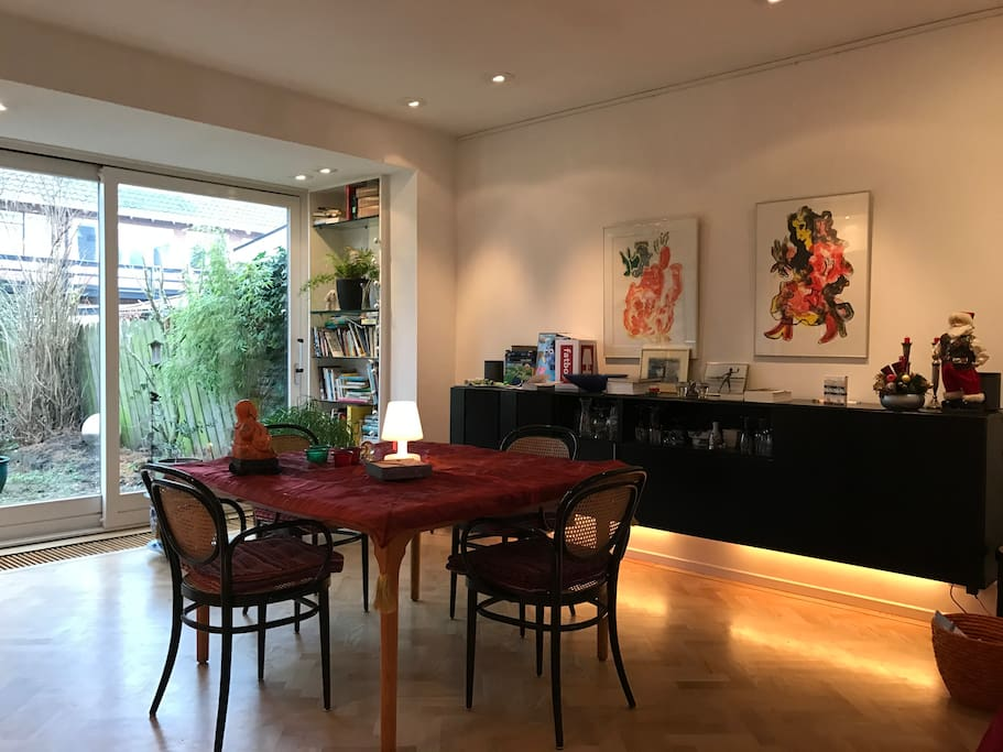 First Floor: Living room, dining table for four persons