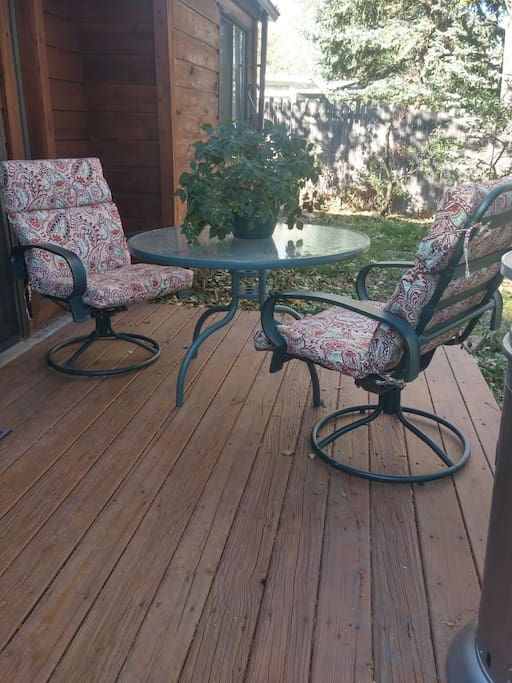 Apartment has a private deck. Enjoy the peace and tranquility of the tree filled backyard.