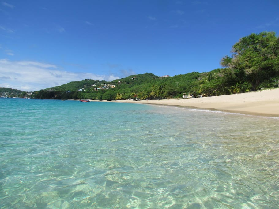 The crystal clear Caribbean Sea at the  bottom of the drive