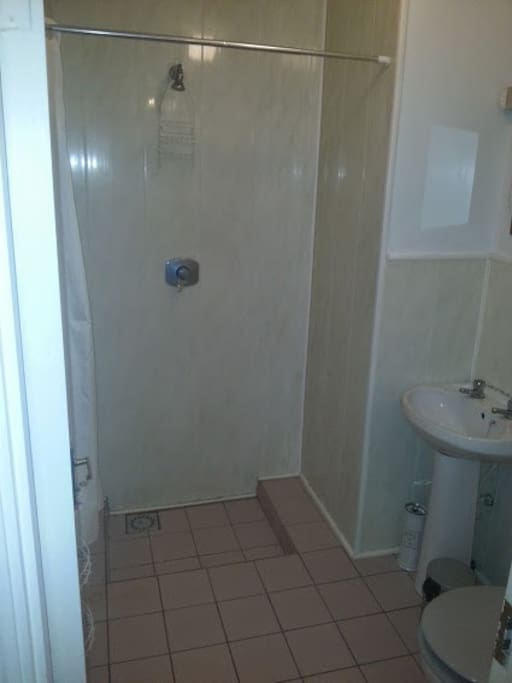 Shared bathroom with shampoo, soap, etc. Towels available on request