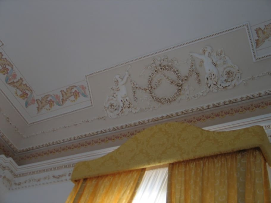 ceiling decorated with cherubs and grounds florals