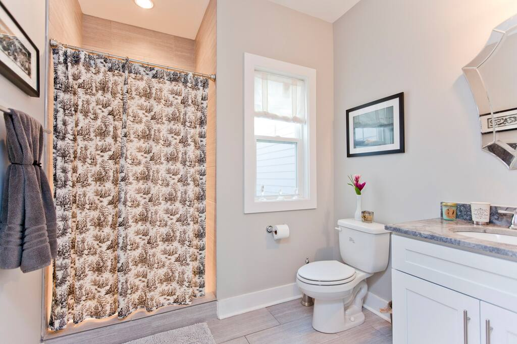 very spacious private bathroom with 10 ft ceilings.
